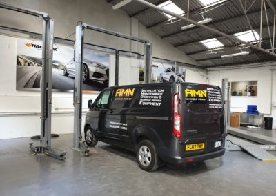 AMN garage assist completing the installation work for the brand new Mr Tyre Warwick site.