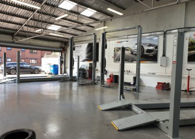 The completed installation of two 4 post rotary lifts and two 2 post rotary lifts.